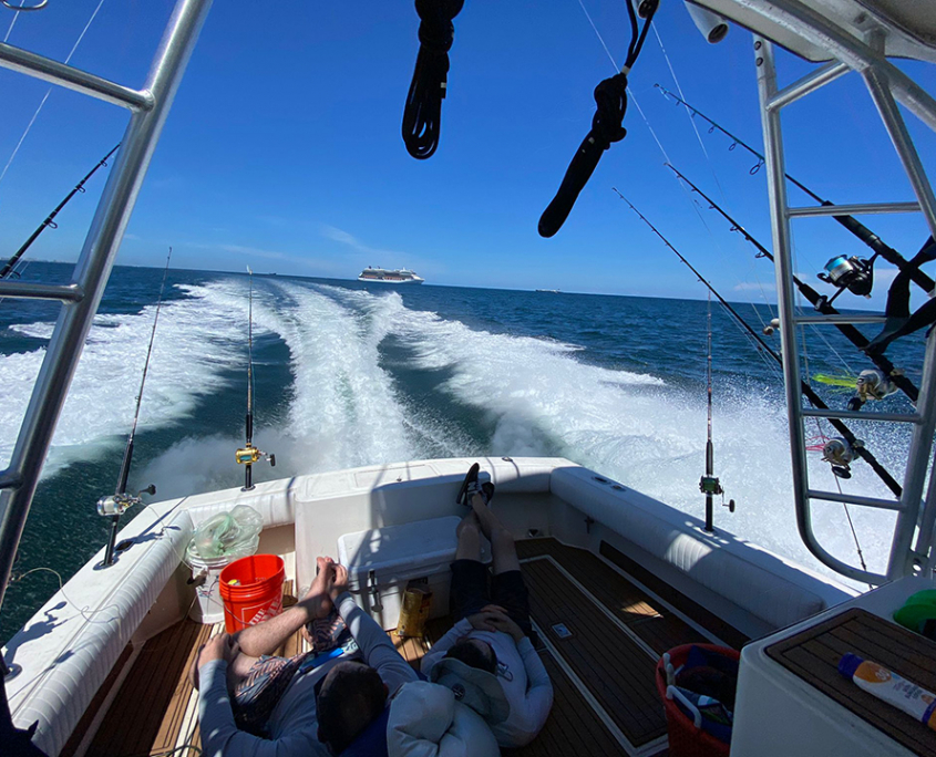Rent a boat fort lauderdale chilling on back of fishing yacht 960